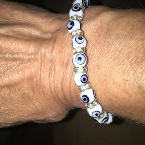 Stretchy white and blue evil eye bracelet